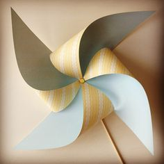 This is for a non-moving pinwheel.  To make a moving one, just use a thumbtack for the center and attach to a skewer or pencil head.