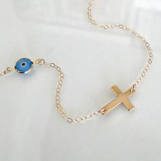 Sideways Cross Necklace With Evil Eye 14K Gold by classicdesigns, $46.00