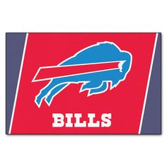 "Buffalo Bills Rug 5x8 - Show your team pride and add style to your tailgating party with Sports Licensing Solutions 5'x8' area rugs. Made in U.S.A. 100% nylon carpet and non-skid Duragon(R) latex backing. Officially licensed and chromojet printed in true team colors.FANMATS Series: RUG5X8Team Series: NFL - Buffalo BillsProduct Dimensions: 59.5""x88""Shipping Dimensions: 31""x20""x6"". Gifts > Licensed Gifts > Nfl > Buffalo Bills. Weight: 15.80"