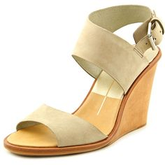 "Dolce Vita Jodi Leather Wedge Sandal Fresco Nubuck 9.5 M. The style name is Jodi. The style number is JODI-FRESCO. Brand Color: Fresco (Main Color: Beige). Material: Leather. Measurements: 3.75"" heel. Width: B(M)."