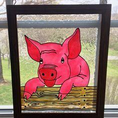 Newest Pig  on a fence framed art.