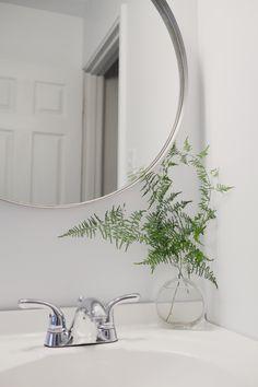 Round mirror in bathroom
