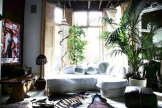 Dark room, loads of plants & natural elements with white sofa and sequins.  This so shouldn't work but it does.