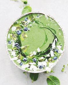 spinach + celery + frozen banana + pea protein + almond milk + coconut water + parsley + mint + chia seeds + spirulina