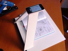 "A book ""scanner"" for your smartphone using foam-core, a craft knife and hot glue."