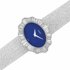 Important Estate Jewelry - Doyle New York. Lady's White Gold, Lapis and Diamond Wristwatch, Piaget 18 kt., mechanical, 64 baguette diamonds ap. 3.75 cts., signed Piaget, ap. 45.4 dwt. Length 6 inches. Sold for $15,000