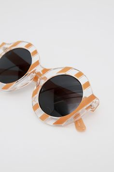 Candy Stripe Sunglasses in Coral! http://www.thewhitepepper.com/collections/eyewear/products/candy-stripe-sunglasses-coral