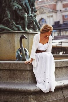 white maxi dress, brown leather belt, white or brown knit...Chocolat Themed Party