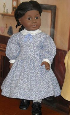Mid 1800's dress and pinafore w/o the pinafore from SugarloafDollClothes on etsy, $85.00.