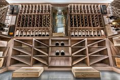Traditional millwork and customized design elements create a warm, modern space that is sure to enhance your home or establishment. If you've been thinking of updating your current wine cellar, or interested in having one designed and installed, visit our website to complete a wine cellar checklist. Just click on our picture! Glass Wine Cellar, Wine Cellar Design, Wine Cellars, Wine Glass, Wood Wine Racks, Modern Spaces, One Design, Design Elements, Construction