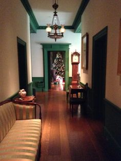 Looking down the hallway to the Christmas tree in the library - The library was where the Dupont family would open their presents on Christmas day    #winterthur