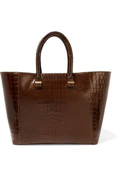 Victoria Beckham's signature 'Liberty' tote is designed in a timeless silhouette you'll wear season after season. Crafted from supple croc-effect leather, this dark-olive style has a spacious canvas-lined interior fitted with large pouch and zipped pockets for easy organization. Its clean lines and understated hardware makes it perfect for the office, too.