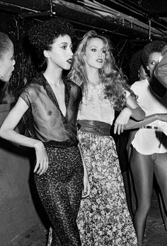 Pat Cleaveland and Jerry Hall backstage at a Studio 54 Jeans fashion show circa 1979