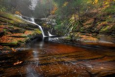 A foggy rainy day along with the sublte swirls of water make this ethereal waterfall come to life.Granby Connecticut.