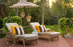 Outdoor patio lounge chairs, love this setup, umbrella, colorful chairpads, lanterns.
