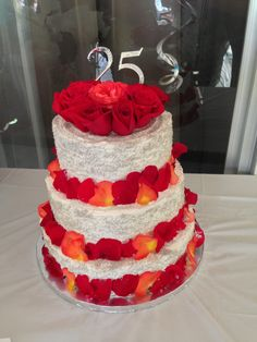 First tiered cake! No experience. Anniversary cake, 3 tiers, buttercream wouldn't stay so covered it with silver crystals and fresh rose petals. Top tier chocolate cake with rasberry filling, bottom two yellow cake one with pineapple second strawberry filling