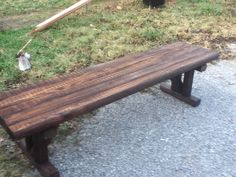 Wooden bench made from landscape timbers.