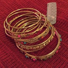Gold colored bangles Very nice, never worn since they're too big for me. Jewelry