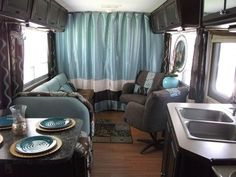DIY Glam RV Remodel with Tufted Wall, Updated our 25 year old RV from mauve pink color scheme to a more appealing brown and aqua/blue interior, featuring my DIY tufted wall in the bedroom and other glam, romantic accents., Living area---Deep chocolate browns and aqua/blue decor carries over into the living area.  The mauve pink carpet is replaced with inexpensive laminate flooring.  The pumpkin stained cabinets got a dark brown coat of paint and new pulls.  The driving c