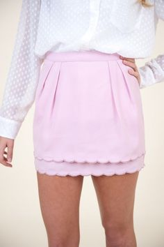 baby pink scalloped skirt.