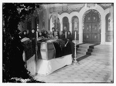 """Funeral ceremony over the remains of Princess Elizabeth, sister of the Czarina & her maid, in the Russian Church of the Magdalene on the Mt. of Olives. Jan. 30th, 1921"" A Grandaughter of Queen Victoria. Ella, as she was known, became a nun & foundress of a Russian orthodox convent, following the assassination of her husband. She was thrown down a mine shaft with other family members, where the Bolshovics then threw grenades.  She is now a saint & martyr in the orthodox church."