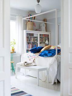 A home in Stockholm, Sweden. I really like that bookshelf!  Photo by Patric Johansson for Ikea Livet Hemma.