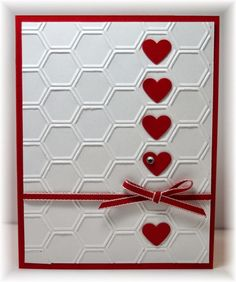 The card - embossing folder used for background is from SU. Added some punched hearts and ribbon. Colors are real red and white.