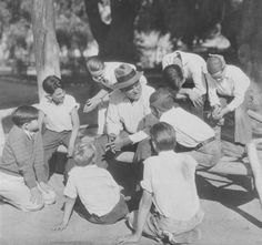 James Jeffries (1875-1953), former Heavyweight Champion of the World, chats with boys from his home town in Burbank, California. Burbank Historical Society. San Fernando Valley History Digital Library.