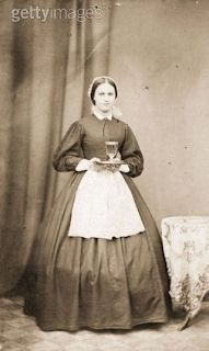 Early 1860s, Small apron compared to the size of the skirt!