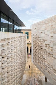 Valletta City Gate: Angular louvers create a dynamic play of reflection and shadow, and the densely textural surface recalls the Baroque richness of local churches and palaces