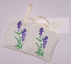 A pair of embroidered organic lavender bags £5.50