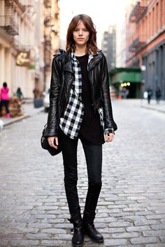 black and white plaid flannel, black leather jacket, black skinny pants or leggings, and black boots.