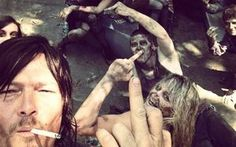 Norman Reedus chillin with the dead - http://www.dravenstales.ch/norman-reedus-chillin-with-the-dead/