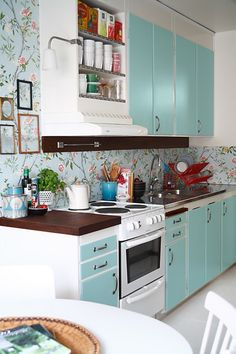 I love how you can make an old kitchen gorgeous without spending $$$$$ or getting a new one.  Maybe a diff wallpaper. I like the color