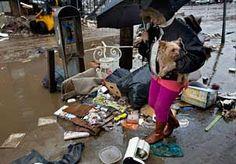 Helena Hamilec walks in the Rockaway Beach neighborhood of Queens, NY, on Wednesday amid debris from superstorm Sandy