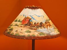 Leather and Rawhide (trim) lamp shade, Western theme, with hand painted wagon and horses.