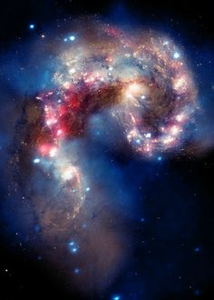 The merging Antennae galaxies - As the two galaxies smash together, billions of stars are born, mostly in groups and clusters of stars. From Hubble Telescope