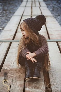 Cute little kid with long hair.