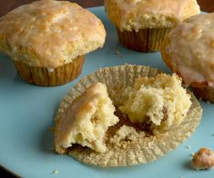 """Instead of the usual dense """"banana-bread"""" texture, these muffins have a light and tender crumb, with slices of ripebanana, chunks ofwalnuts, and a sweet cinnamon glaze."""