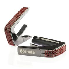 """""""Thalia Capo 200 in Black Chrome Finish with Swarovski Crystal Siam inlay. Every capo comes in a clear polycarbonate jewel case along with a microfiber cleaning/gig pouch and our We buy our Swarovski crystals direct from E.H. Ashley, the official Swarovski distributor in the USA. BOTH our Rubber & Sliding Teflon Fretpad Tuning Kits"""" https://www.www.www.thaliacapos.com//collections/all/products/black-chrome-finish-with-swarovski-crystal-inlay…"""