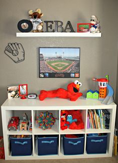 LOVE the shelving and the glove! Will do a football on the other side! Brodie is DEFINITELY his Pod-It's grandson! Pod-It is starting him young so maybe we can sit in the stands and cheer for him when he plays Pro :)