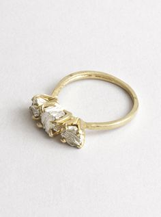 LOVE this. Dandelion ring by Macha Jewelry.