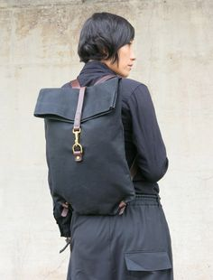 Waxed Canvas Postal backpack via KikaNY. Click on the image to see more!