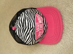 A vans off the wall zebra and pink SnapBack hat.