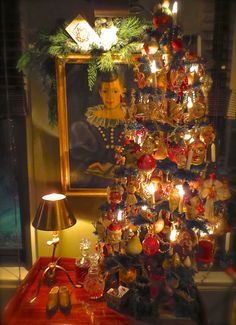 Feather tree in the study hung with German figural glass ornaments, cotton ornaments and wax angels