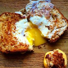 This is a grilled cheese sandwich with an over-easy egg cooked INSIDE of it.