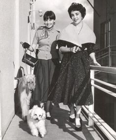 Leslie Caron and Elizabeth Taylor, 1950s - that's a wholesome picture with these dogs and all!