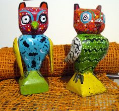 Traditional owl wood sculptures, hand carved and painted, would be wise to snag a few.