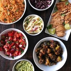 Something about the cold weather today motivated my husband and me to stay in a cook! Our favorite Mexican rice, simmered black beans, Mexican-spiced grilled chicken, tangy orange jicama slaw, tomato salsa, guacamole, and pineapple-glazed Brussel sprouts. Each dish was simple to make but since we made so much, it required both of us in the kitchen for a couple hours but it was worth it!