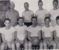 Uncle Herb, back row, second from the right. They were the ship's championship basketball team while onboard USS Makassar Strait during World War II.
